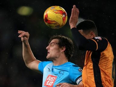 Chris Martin and Curtis Davies battle for a high ball