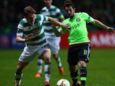 James Forrest of Celtic challenges Amin Younes