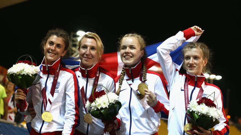 Olivia Breen (left) celebrates relay gold for Britain in Doha