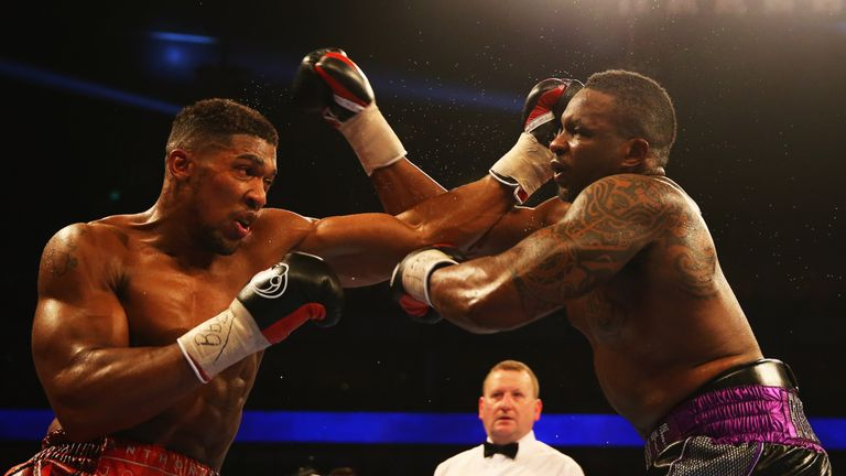 Joshua (left) knocked out Dillian Whyte in his last fight