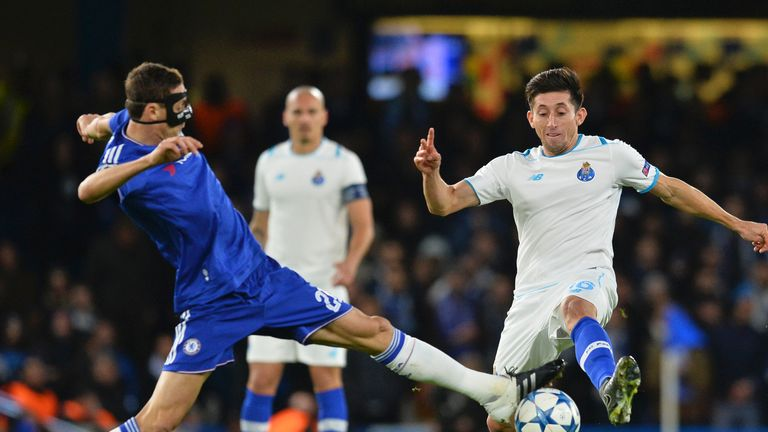 Nemanja Matic makes a tackle against Porto while wearing a face mask