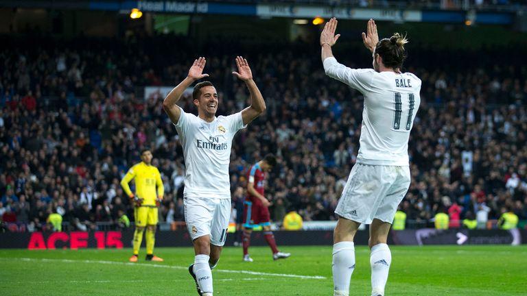 Lucas Vazquez (left) celebrates scoring Real Madrid's third goal with Gareth Bale