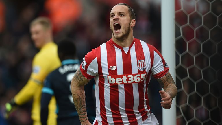 Marko Arnautovic celebrates after scoring his second goal for Stoke, with again City full-back Sagna having been caught out of position