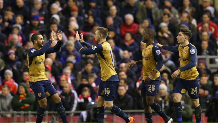 Aaron Ramsey (second left) celebrates scoring Arsenal's first goal at Liverpool, where a late Joe Allen equaliser denied them victory