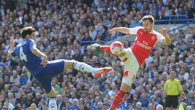Aaron Ramsey strikes under pressure from Cesc Fabregas