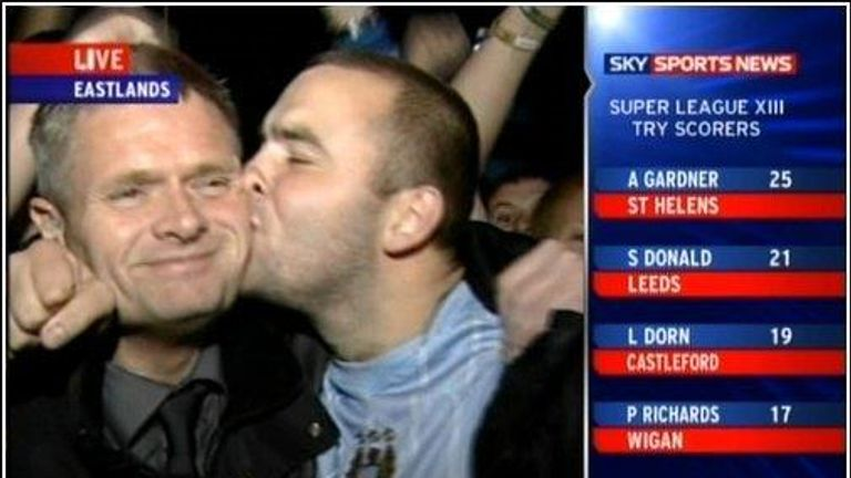 Former SSN reporter Alan Myers is kissed by a Manchester City fan after the signing of Robinho