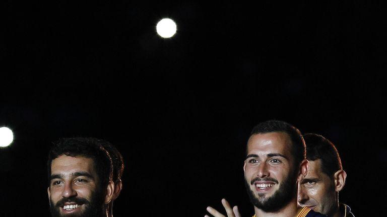 Barcelona's Turkish midfielder Arda Turan (left) and defender Aleix Vidal (right)