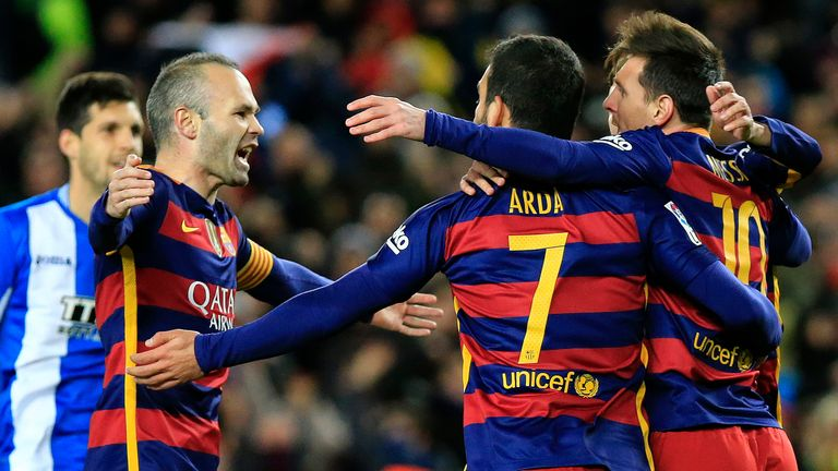Barcelona's Lionel Messi celebrates with Arda Turan and Andres Iniesta (L) after the Argentine equalised against Espanyol