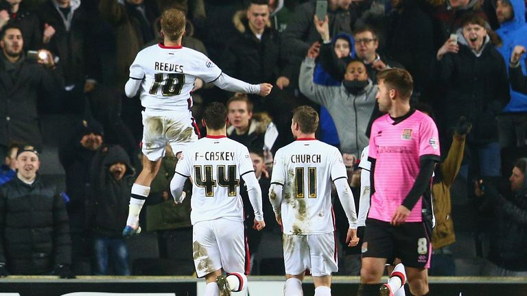 MK Dons set up the fourth-round Chelsea tie with a 3-0 victory over local rivals Northampton