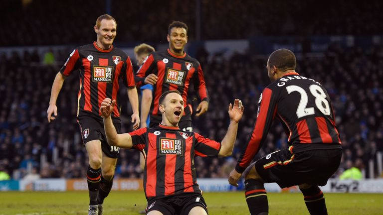 Marc Pugh (middle) of Bournemouth celebrates scoring his team's winning goal against Portsmouth
