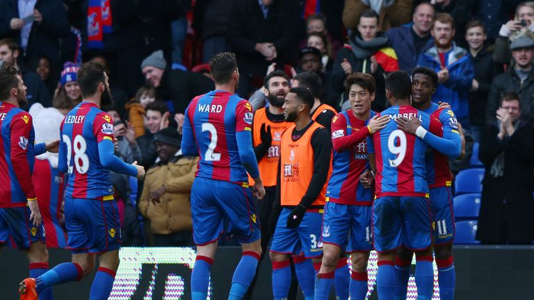 Wilfried Zaha (far right) of Crystal Palace celebrates scoring his team's goal against Stoke