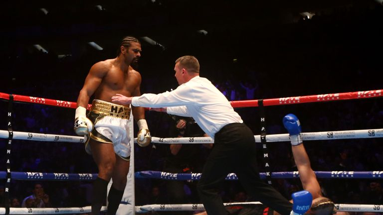 Haye is pushed away by the referee after knocking out De Mori
