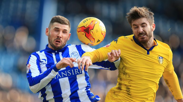 Gary Hooper (left) and Luke Murphy tussle at Hillsborough