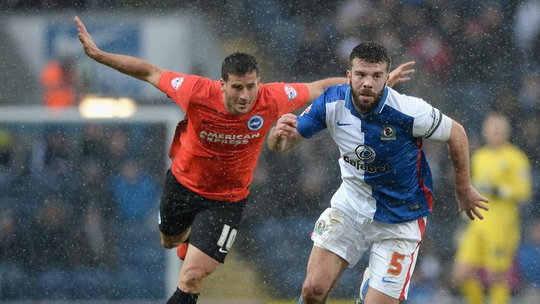 Grant Hanley gets past Tomer Hemed during the game at Ewood Park.