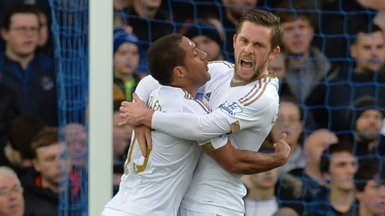 Gylfi Sigurdsson celebrates after scoring from the penalty spot