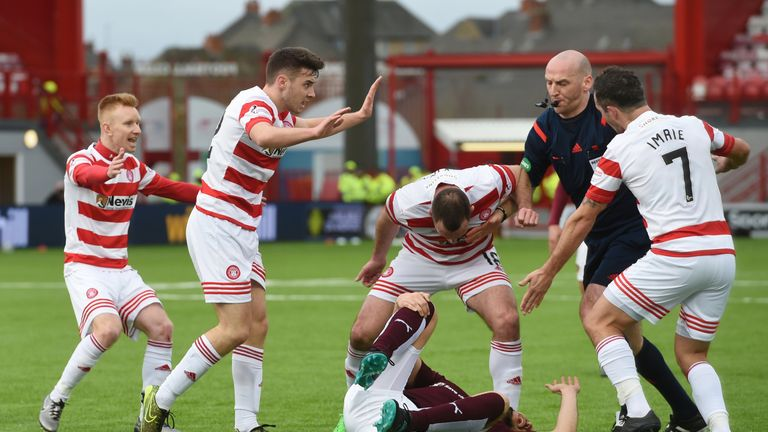 Hamilton players Darian MacKinnon (centre) and Dougie Imrie reacted angrily to Rossi's challenge