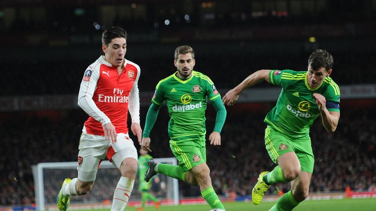 Hector Bellerin (L) takes on Billy Jones during Saturday's FA Cup tie