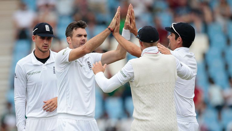 England's bowler Jimmy Anderson (2nd L) celebrates the dismissal of South African batsman Dean Elgar (not pictured) during day 3 of the fourth Test