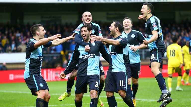 Joe Jacobson (second left) of Wycombe celebrates scoring from the penalty spot