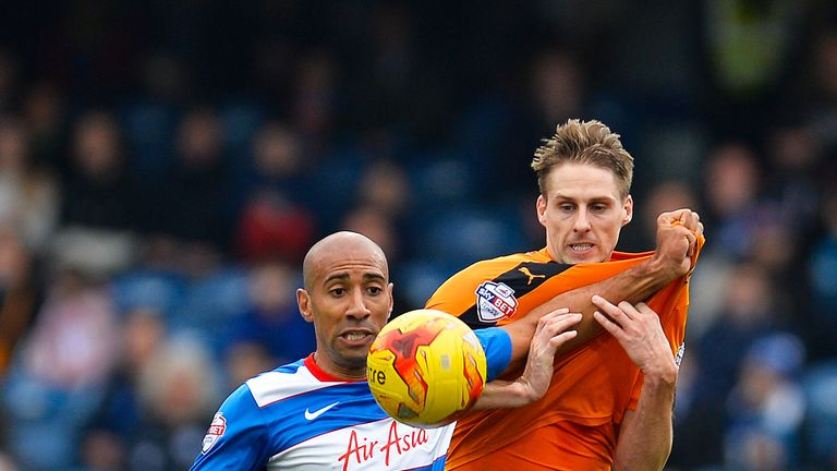Karl Henry of QPR and David Edwards of Wolves battle for the ball