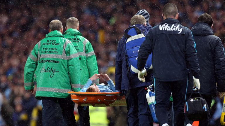 Manchester City's Kevin De Bruyne leaves the pitch injured on a stretcher during the Capital One Cup, semi final, second leg at the Etihad Stadium