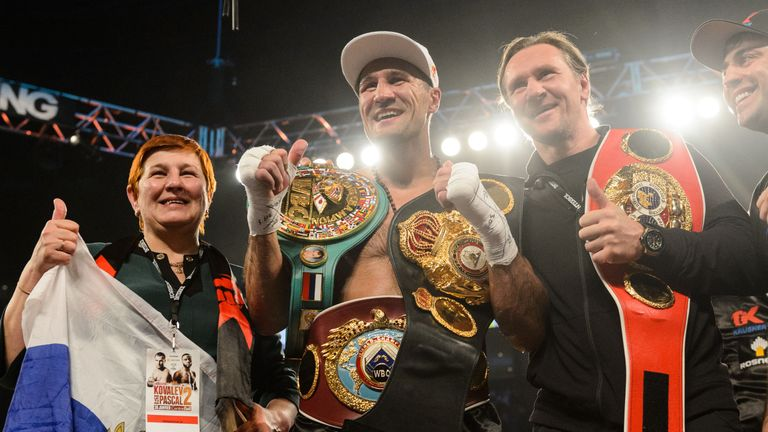 Sergey Kovalev with the WBO, WBA and IBF belts