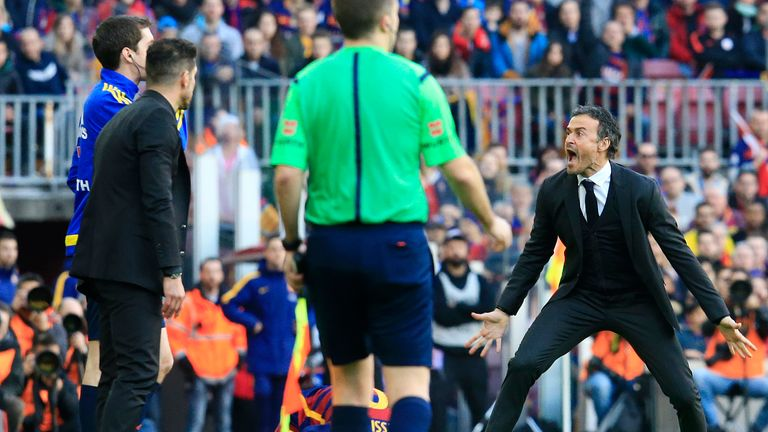 Barcelona's coach Luis Enrique (right) rages at the assistant referee after Filipe Luis' foul on Lionel Messi