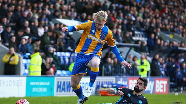Jack Grimmer of Shrewsbury Town is tackled by Sheffield Wednesday's Marco Matias