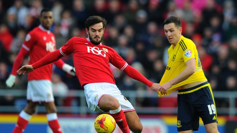 Marlon Pack knocks the ball away from Stewart Downing