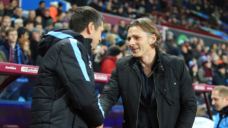 Remi Garde shakes hands with Gareth Ainsworth before the game