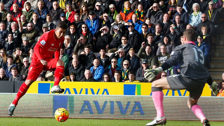 Roberto Firmino (left) scores Liverpool's first goal