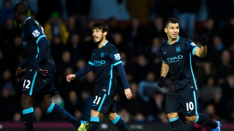 Sergio Aguero (right) celebrates scoring Manchester City's first goal