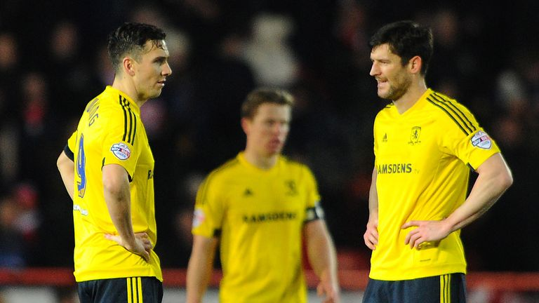 Stewart Downing and David Nugent show their disappointment
