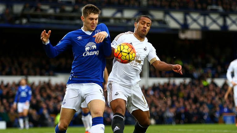 John Stones of Everton battles for the ball with Swansea' Wayne Routledge