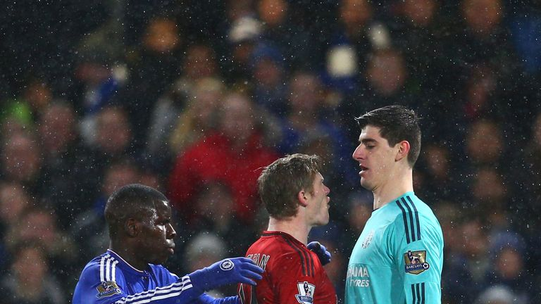 Thibaut Courtois squares up to West Brom goalscorer James McClean during Chelsea's 2-2 draw