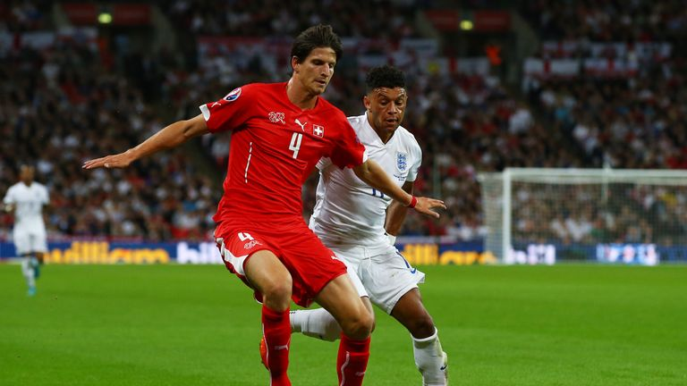 Timm Klose in action for Switzerland against England's Alex Oxlade-Chamberlain