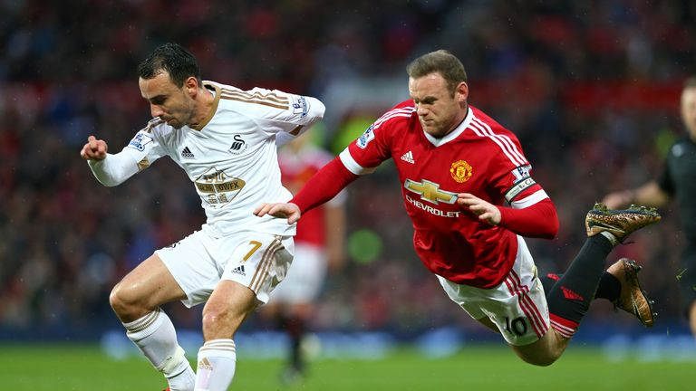 Rooney challenges with Leon Britton for the ball