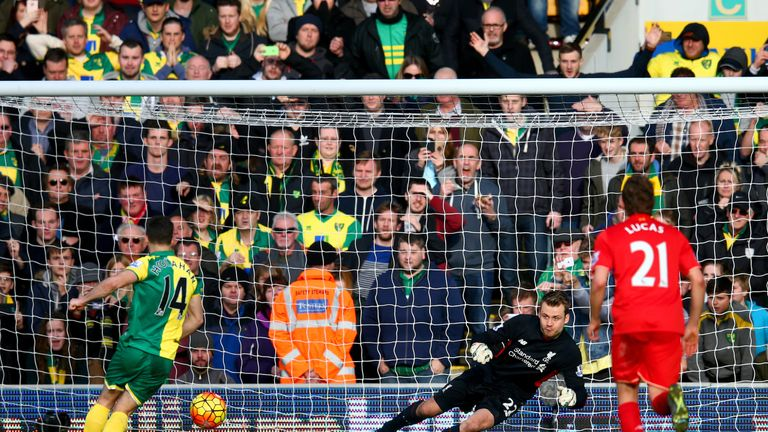 Wes Hoolahan (left) puts Norwich 3-1 up from the penalty spot