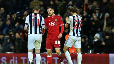 Wes Burns (centre) has a new one-year deal with Bristol City