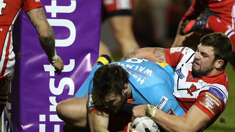 Alex Walmsley powers his way over for St Helens' first try