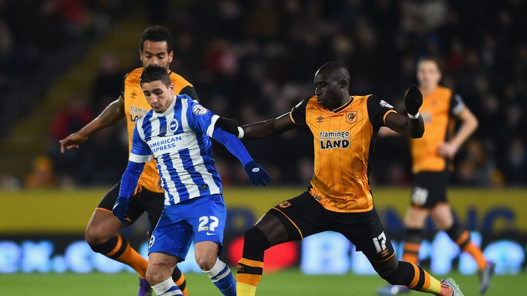 Anthony Knockaert of Brighton battles with Tom Huddlestone and Mo Diame
