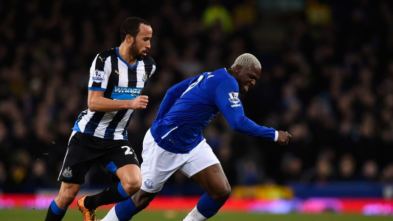 Andros Townsend (left) keeps tabs on Aroune Kone