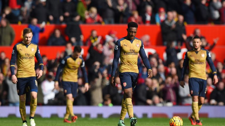 Arsenal players look dejected after conceding against Manchester United