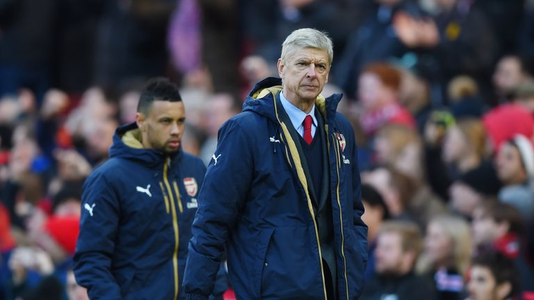 Arsene Wenger walks back to the dressing room after seeing his side lose at Old Trafford