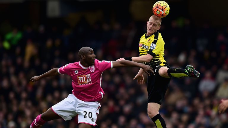 Ben Watson of Watford heads the ball away from Bournemouth's Benik Afobe