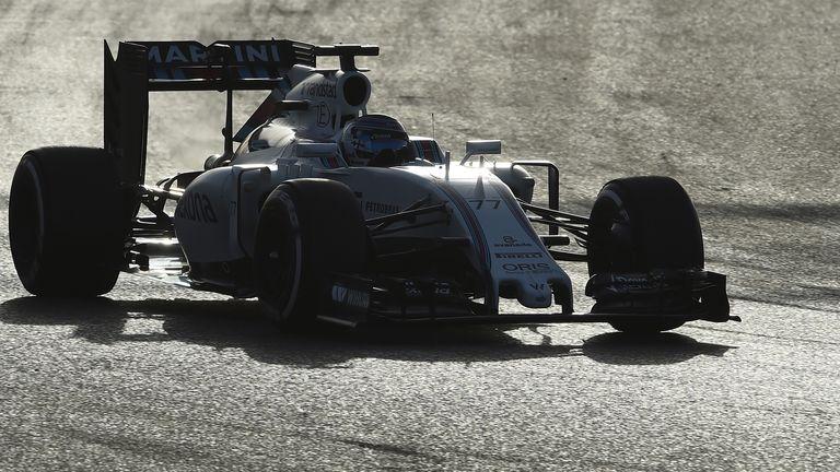 Valtterri Bottas cuts through the evening dusk in his Williams