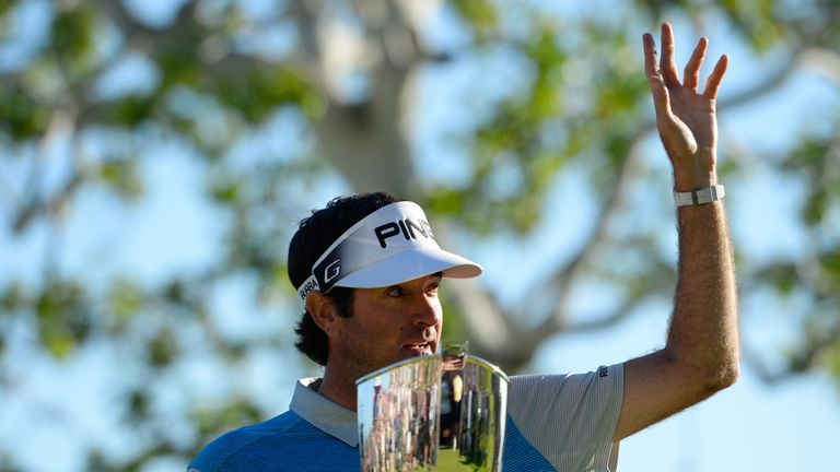 Bubba Watson poses with the trophy after putting in to win on the 18th hole during the final round of the Northern Trust Open