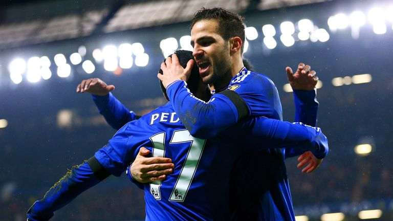 Cesc Fabregas celebrates with Chelsea team-mate Pedro at Stamford Bridge