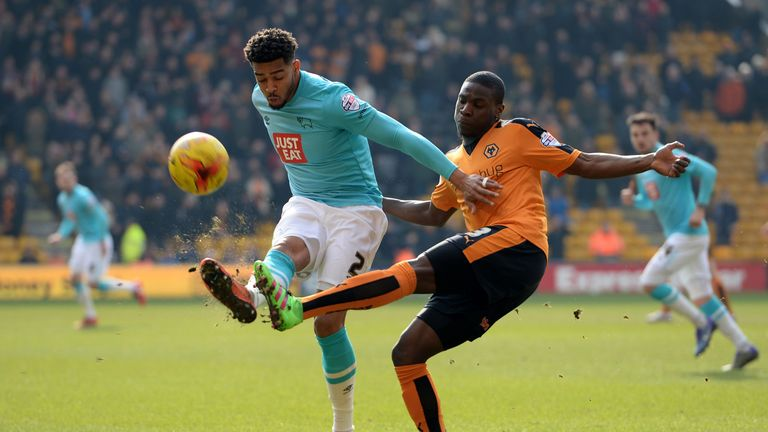 Jeremy Helan of Wolves tackles Derby's Cyrus Christie.