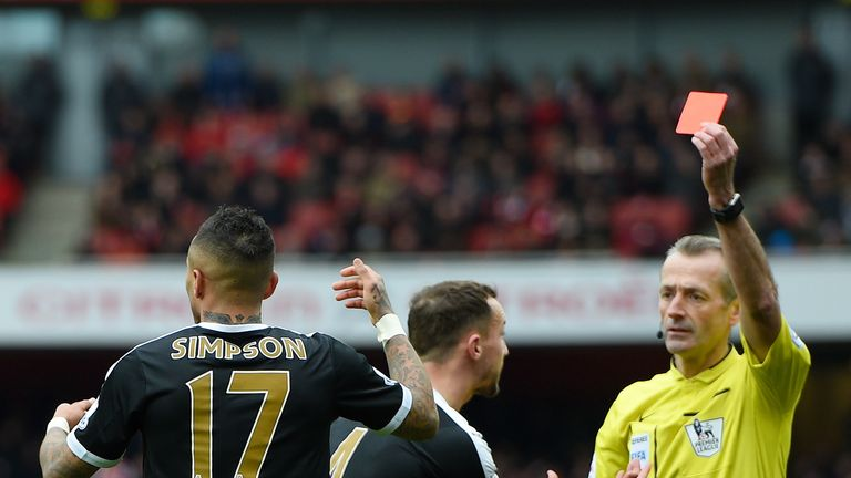 Danny Simpson was sent off following a tangle with Olivier Giroud